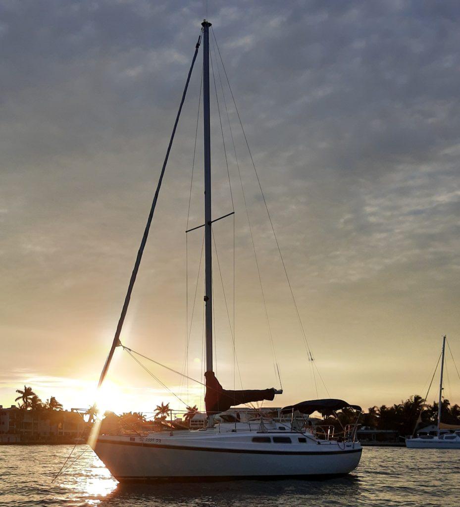 Sunset Behind Sailboat